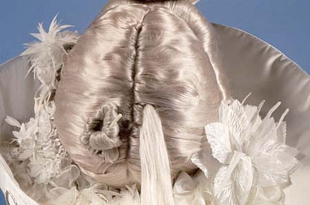 Millie Wilson, White Girl (Detail) 1995, synthetic hair, satin, feathers, fox tail, pottery, etc.