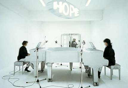 Christian Tomaszewski, Untitled (HOPE) 2002, installation, revolving door and sign, two pianos, two pianists, four microphones, amplifier, cd