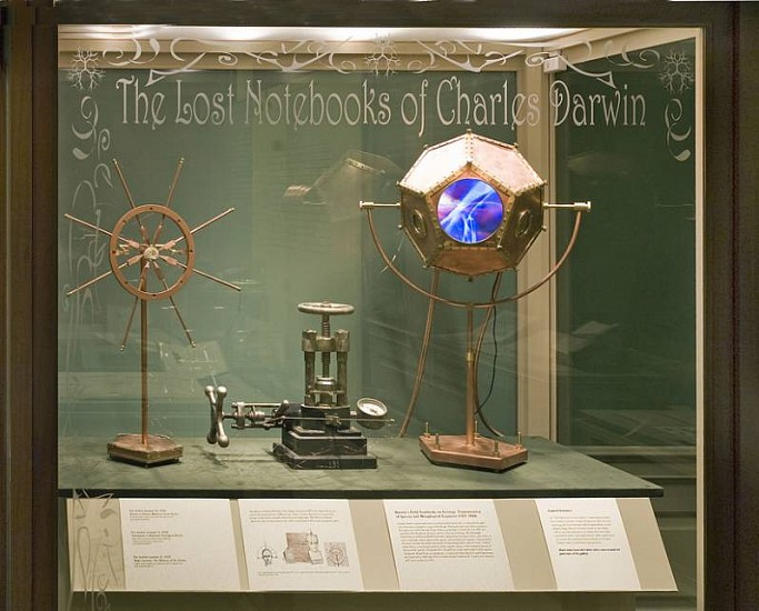 Eve Laramee, Luminous Darwin: The Lost Notebooks of Charles Darwin 2009, copper, brass, stone marine fossil, glass lens, video, cast iron
