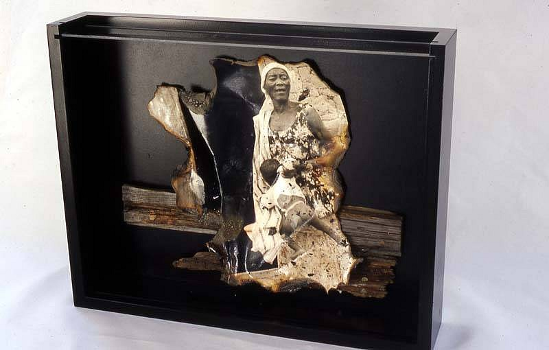 Norma Holt, Cry Africa 2003, burnt photo, burnt wood adhered to images in wood and glass box