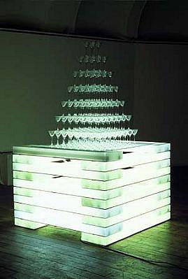 Aleksander Garbin, Taiwwantower 2002, neon fittings, cocktail glasses, Buda statuette of malleable stone, glass