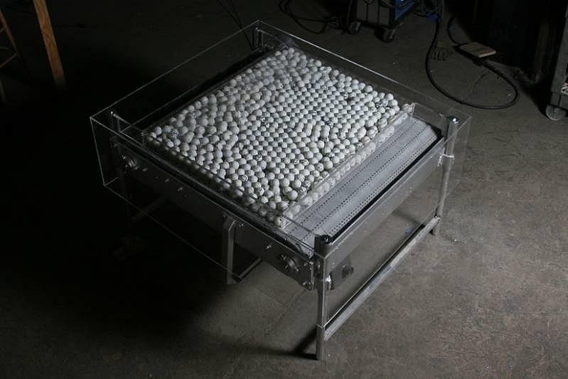 Barbara Cohen, Moving On 2007-10, motorized conveyor belt, metal base, graphite drawn on ping pong