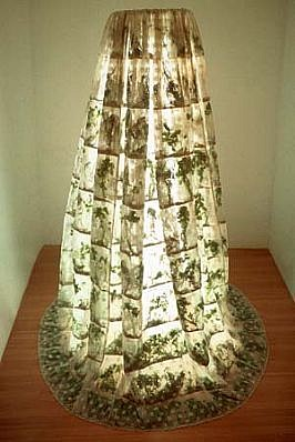 Michele Brody, Culantro En/Agua 2001, lace sewn into horizontal pockets stuffed with cilantro, lights, steel