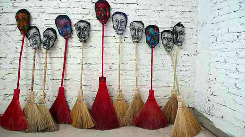 Marisa Boullosa, Cotidianamente...(Everyday...) 2009, installation, brooms, linocut print on cotton, red paint