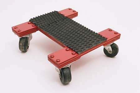 John Beech, Small Rolling Platform 1998, plywood, casters, rubber, enamel