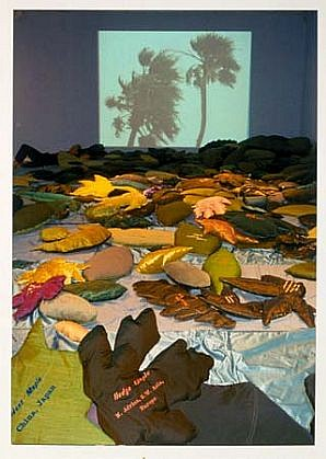 Kim Abeles, Leaf Leap (All the World's Leaves) 2000, 450 fabric leaves created 5X their normal size, ea. embroidered with its name and global origin, sound and video projection of trees in wind, lavender