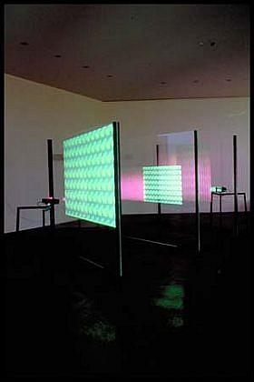Iole Alessandrini, Schizophrenic- a/o 2001, plexiglass, metal, video sound