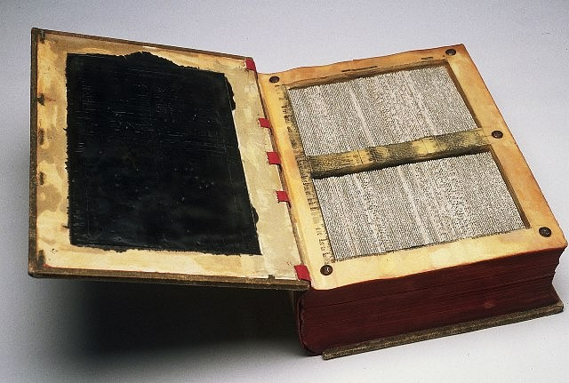 Crystal Cawley, Ledger 2005, altered book, beeswax