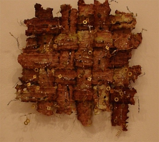 Sandra Golbert, Shield III hand-made paper over wire, brass, sequins