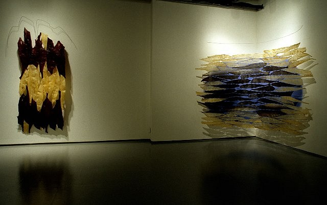 Carol Hepper, Red Bands, 2001 (on left) Iris, 2003 (on right) 2001-2003, fish skin, fishing line, pigment, wall paint, wire