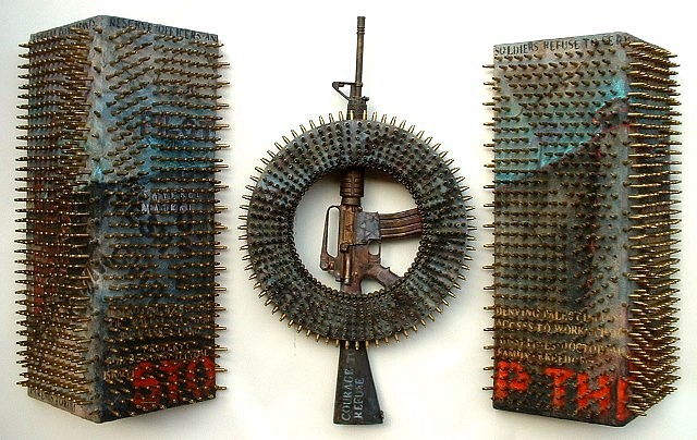 Suzanne Klotz, Cracks in the Wall 2005, wood, bullet shells, replica M-16 rifle