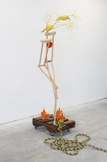 Rachel Owens, Self-portrait 2008, crutches, palette, wheels, rope, branches, glass, plastic, reflector