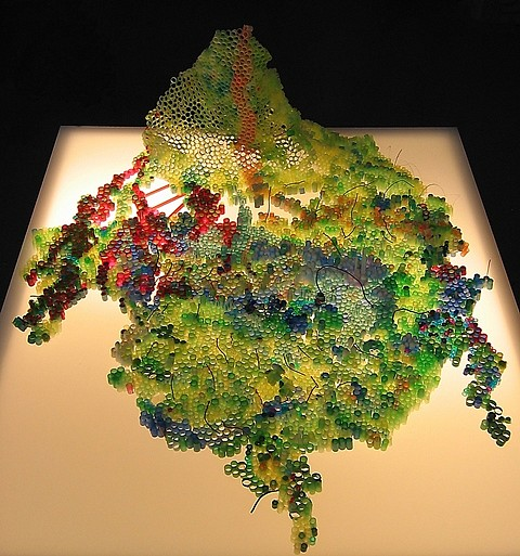 Annie Varnot, Perelandra 2006, plastic drinking straws, pompoms, Pearler Beads, colored wire, illuminated pedestal