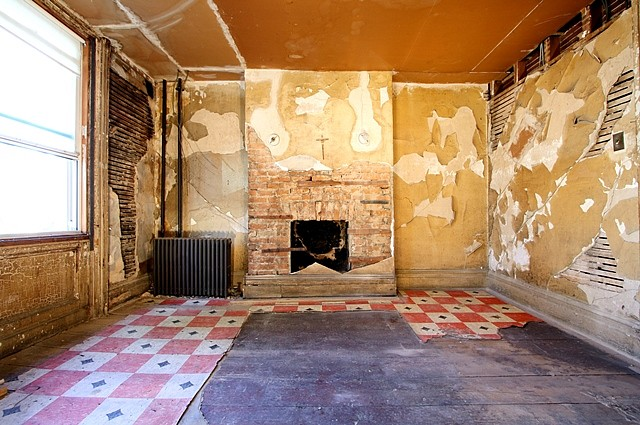 Amanda C Mathis, Infestation (116 Devoe Street), View A 2010, home interior: plaster lathe, drywall, brick, paint, linoleum flooring, wood flooring, molding