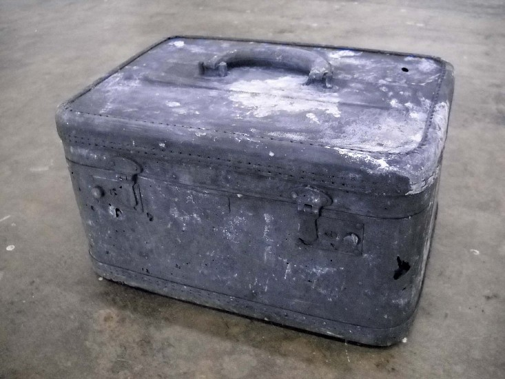 John Jurayj, Untitled (Woman's Travel Case) 2010, cast gunpowder and plaster