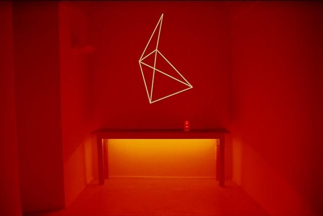 Stefano Bonacci, Giardino segreto 2002, installation of wood table, glass, water, projection, red neon