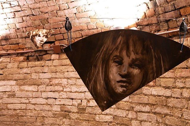AM Hoch, Metamorfosi di una barca (faces in mirrors) 2011, painted mirrors suspended with wires and pulleys