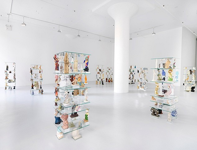 Patrick Jackson, Tchotchke Stacks 2010, tchotchkes, glass mirror and wood