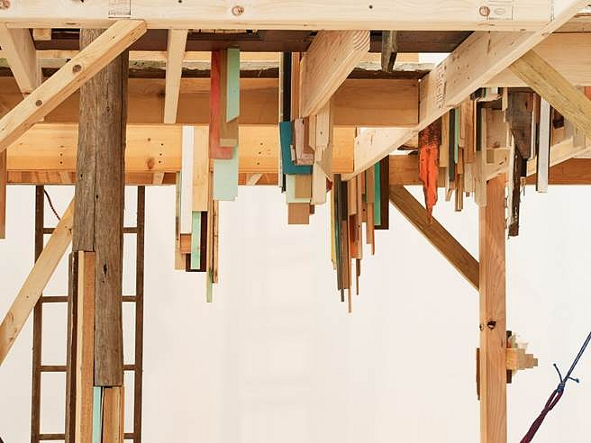 Janelle Iglesias, In High Feather (Ground Level View Under the Structure) 2014, Scavenged wood, doors, pallets, used Christmas Trees, seashells, hammock and miscellaneous scavenged objects and materials