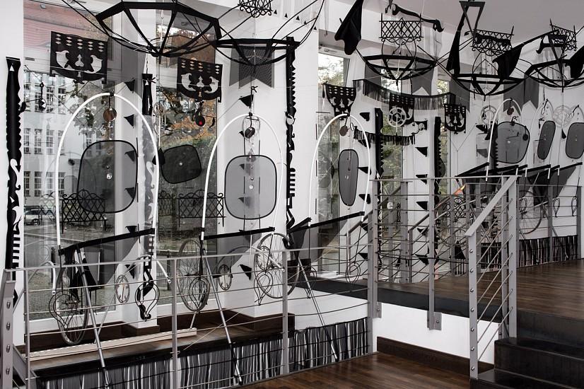 Li Ma, Ear Temple in Fan Land 2015, bicycle wheel, broom, fabric, mirror, feather, wind chain, bell, fan, metal, car windshield, umbrella, straw, pin, rope, nail, fog machine, bike mirror, etc.